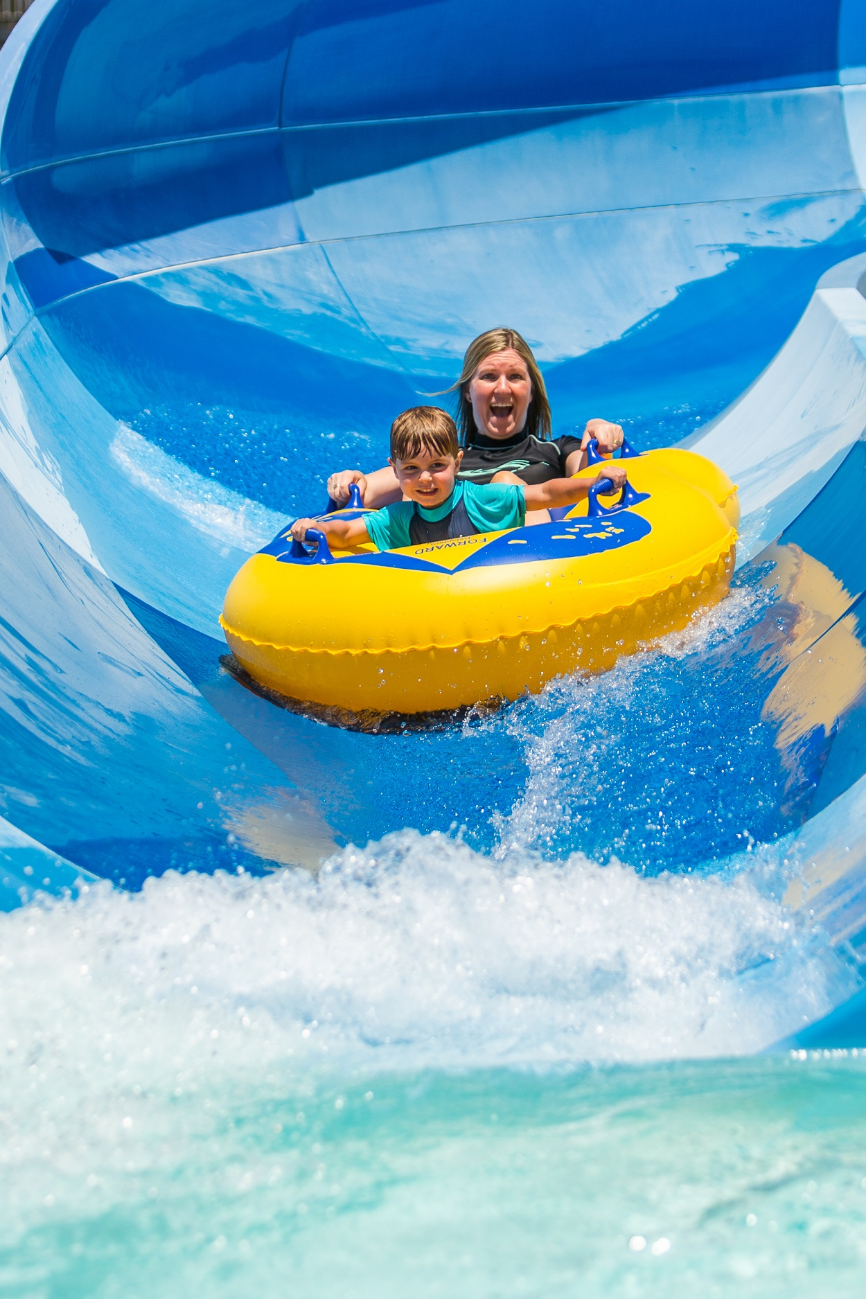mum and son on blue water slide