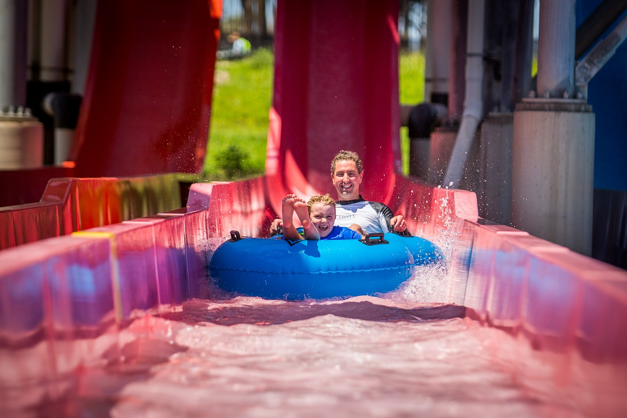 mum and son on red water slide